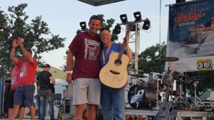 John Adams winning a signed guitar by LOCASH and Casey M.