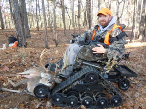 wounded veteran in a tank chair on a mobility Impaired Hunt